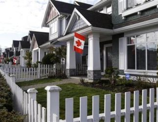 Canadian flags are seen on houses in the Vancouver suburb of Richmond prior to the Vancouver 2010 Winter Olympic Games February 9, 2010. REUTERS/Chris Hellgren